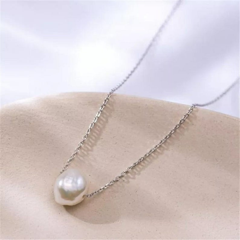 Gold single pearl necklace Floating Pearl Necklace The Colourful Aura